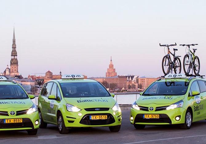 Il bici taxi, a Riga