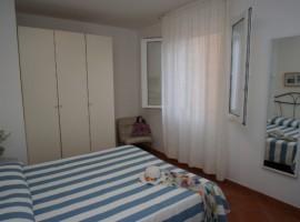 Camera da letto di Villa Andrea. La biancheria è lavata con prodotti ecologici.