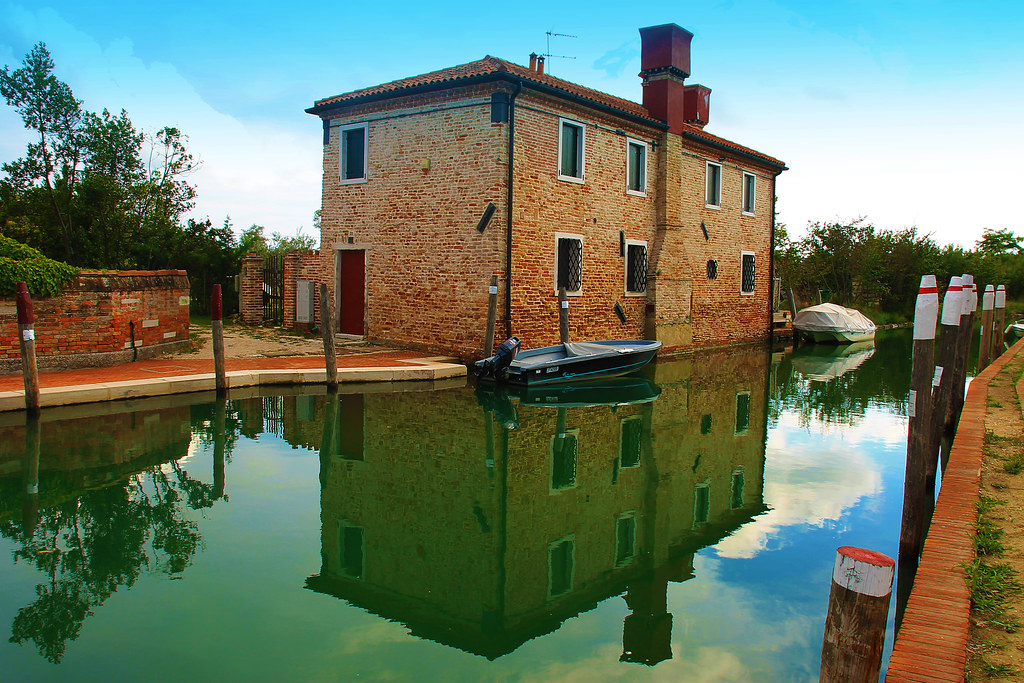 Torcello's canal with a house on it