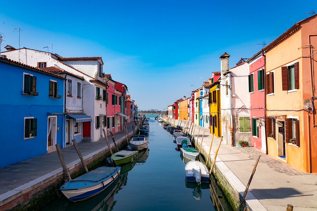small canal of Burano with the typical houses and its bright colours